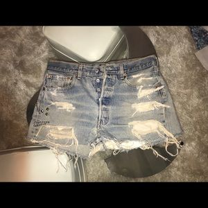 "Levi's distressed cut off jean shorts: 32"" or L"